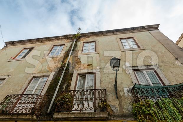 Rundown Lisbon house facade Stock Photo