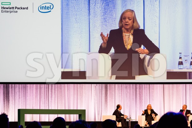 HPE president and chief executive officer Meg Whitman in conversation with other HPE managers Stock Photo