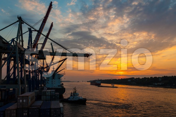 Large container ships at the Container Terminal Buchardkai in Hamburg at dusk Stock Photo