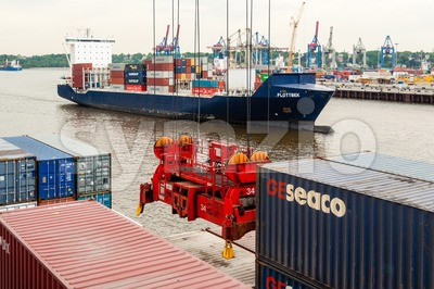 Large container ship at the Container Terminal Altenwerder in Hamburg Stock Photo