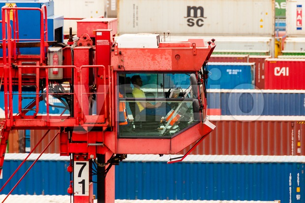Straddle carrier serving containers at the Buchardkai Container Terminal in Hamburg Stock Photo