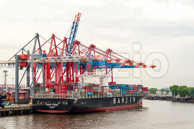 Large container ship at the Container Terminal Buchardkai in Hamburg Stock Photo
