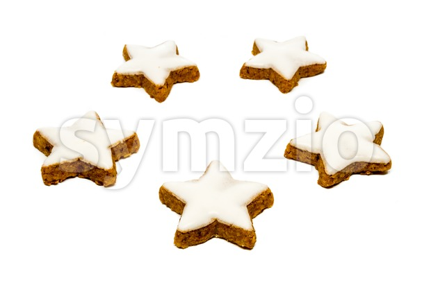 Christmas star shaped cookies with white icing isolated on a white background