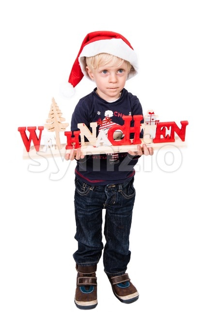 Boy with German Christmas greetings Stock Photo