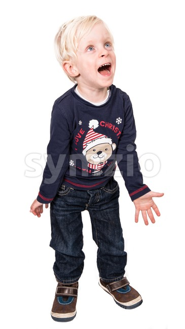 Magic of Christmas. Cute and excited boy on white Stock Photo