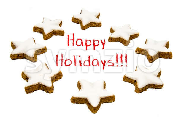 Christmas star shaped cookies with white icing isolated on a white background and red text - happy holidays