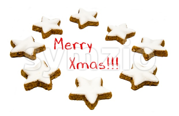 Christmas star shaped cookies with white icing isolated on a white background and red text - merry xmas !!!