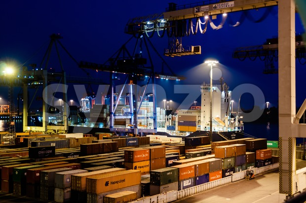 Buchardkai Container Terminal in Hamburg at night Stock Photo