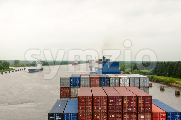 Passage of a container ship through the Kiel Canal Stock Photo