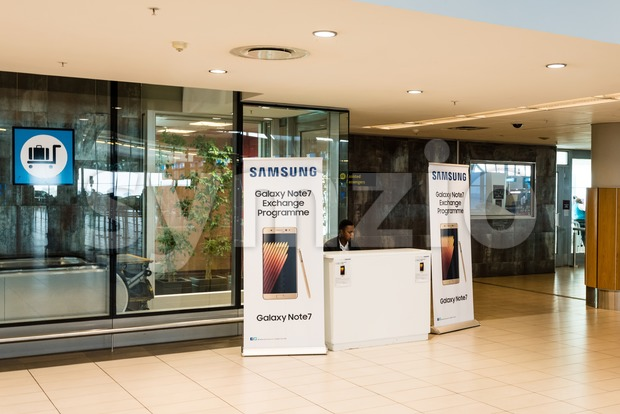 Cape Town, South Africa - November 24, 2016: A booth for exchanging the Samsung Galaxy Note 7 at the airport ...