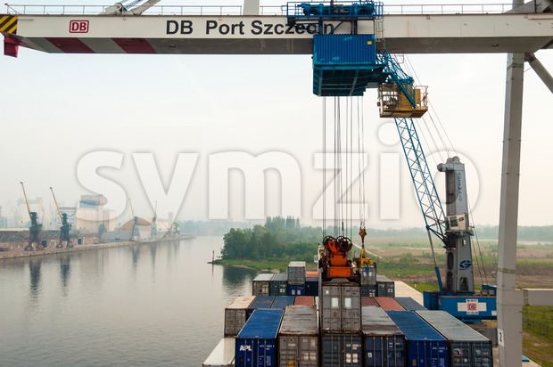 Unloading a container ship in Stetting sea port, Poland Stock Photo