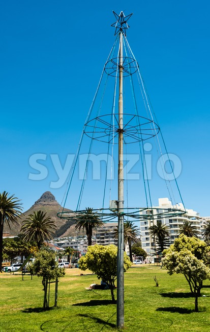 Christmas tree beside the sea in Cape Town, South Africa. Lion's Head mountain on the background. Stock Photo