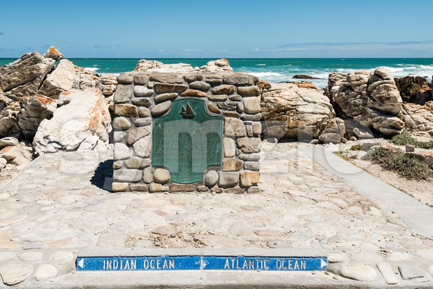 The plate of Cape Agulhas, at the southern edge of the village of L'Agulhas, in Agulhas National Park, the southernmost ...