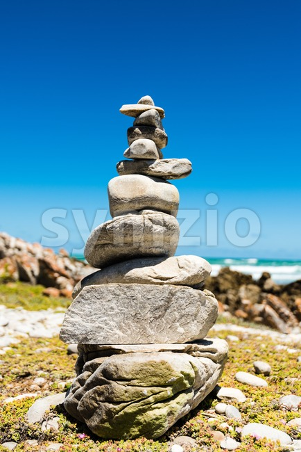 Balanced stack of stones on the coast of the ocean. Zen design concept