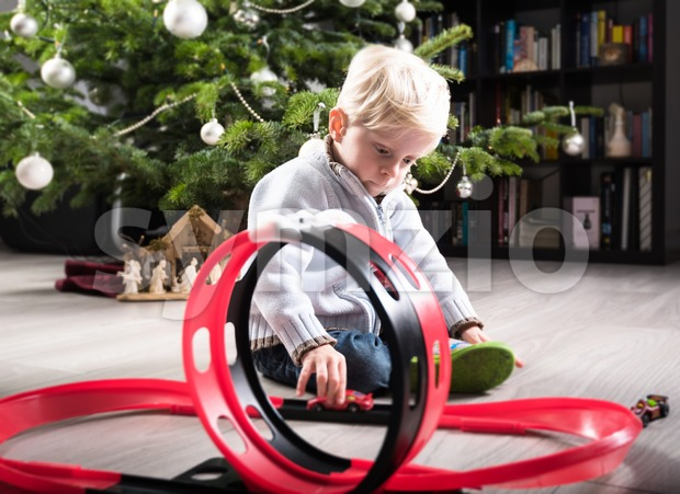 Boy playing with Christmas present Stock Photo