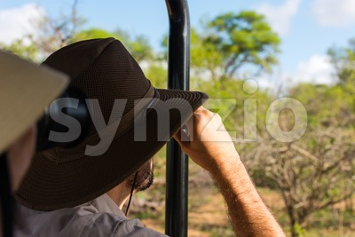 Young couple on safari in jeep looking Stock Photo