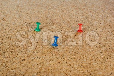 Thumbtack pins on pinboard Stock Photo