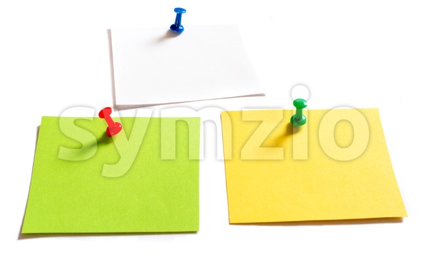 3 coloured thumbtack pins with notepapers with shadows on white studio background - copy space for your text