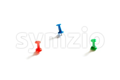 Thumbtack pins on white Stock Photo