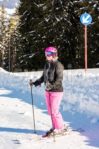 attractive middle aged woman with ski and snow Stock Photo