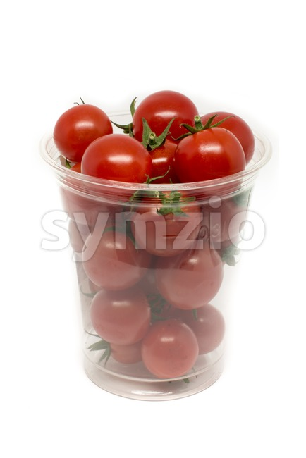 Box of fresh sweet cocktail tomatoes on a white background, studio shot
