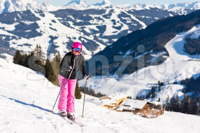 Female skier close to skiing hut Stock Photo