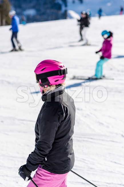 Female skier in fresh snow Stock Photo