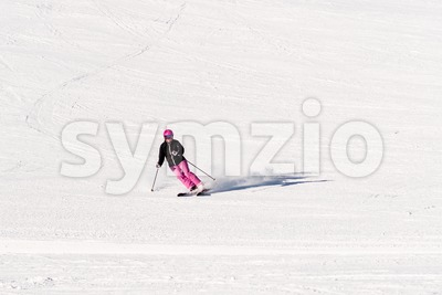 Female skier on empty ski slope Stock Photo