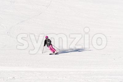Female skier on empty ski slope Stock Photo