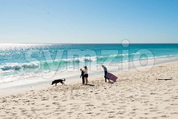 Family on the beach at Bloubergstrand in South Africa, facing Table Mountain. Stock Photo