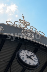 Old Clock Under The Roof Stock Photo