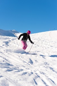 Female skier in fresh powder snow Stock Photo