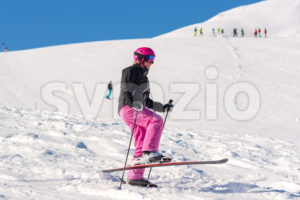 Female skier having fun in fresh snow Stock Photo