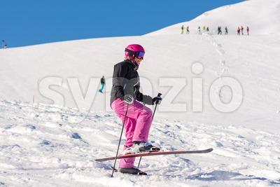 Female skier having fun in fresh snow Stock Photo