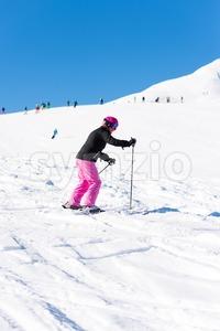 Female skier in fresh snow Stock Photo