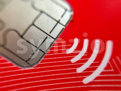 A closeup of credit card chip with wireless symbol Stock Photo