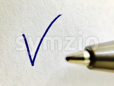 Check - ballpoint pen and checkmark Stock Photo