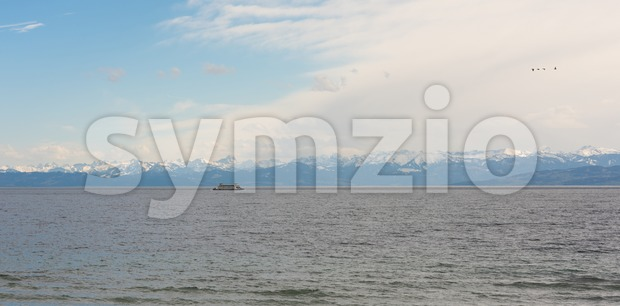 Beautiful panorama of the alps at Lake Constance (Bodensee) with ferry approaching Konstanz