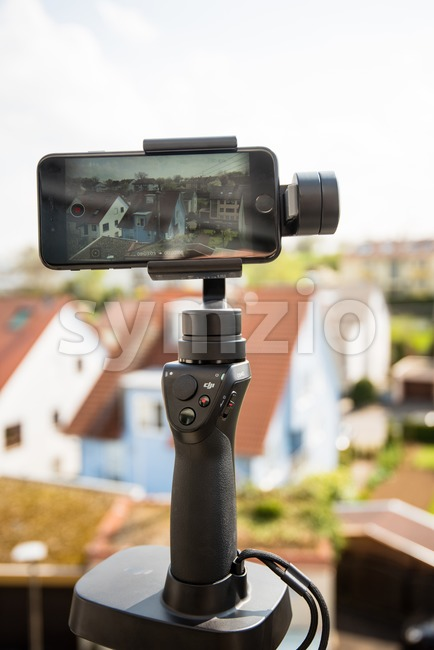 Ostfildern, Germany - April 5, 2017: A DJI Osmo Mobile with stand is in action filming a panoramic timelapse video ...