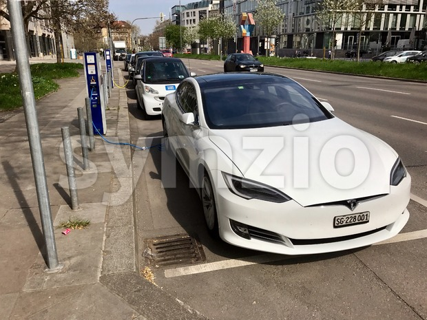 Stuttgart, Germany - April 1, 2017: A Tesla Model S with Swiss numberplates is being charged at a charger in ...