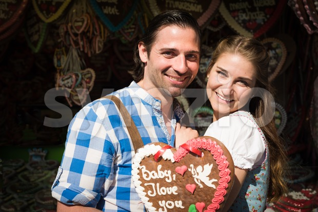 Young couple in love at Oktoberfest Stock Photo