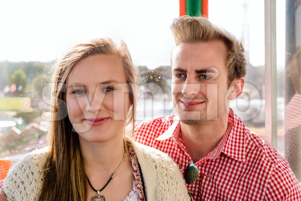 Couple inside a Ferris wheel on Oktoberfest Stock Photo