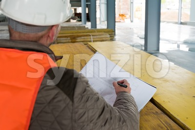 Construction supervisor with plan on site Stock Photo