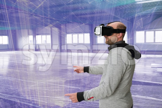 Architect with VR visor exploring industrial building environment Stock Photo