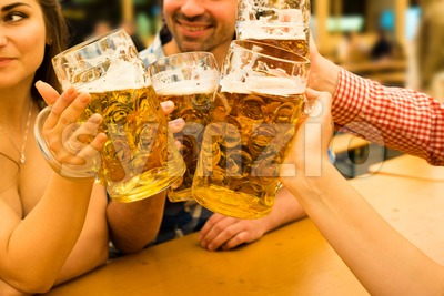 Couples having fun at the Oktoberfest Stock Photo