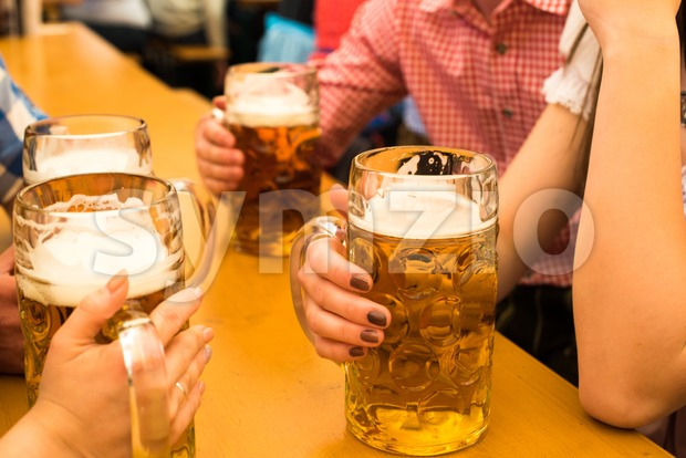 Couples having fun at the Oktoberfest Stock Photo