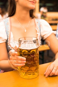 Beautiful young woman with beer stein at Munich Oktoberfest Stock Photo