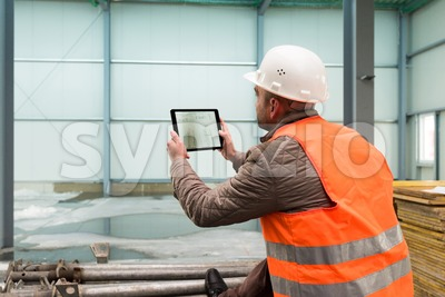 Construction supervisor with digital tablet on site Stock Photo