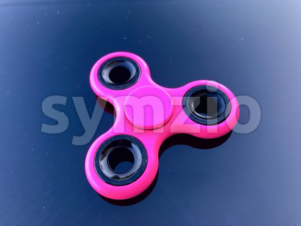 purple fidget spinner stress relieving toy Stock Photo