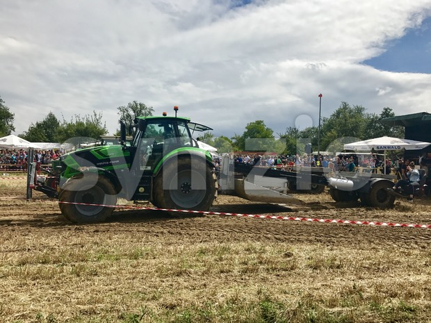 Tractor pulling heavy weight Stock Photo